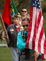 Ground Blessing Ceremony photo of man with flag.jpg